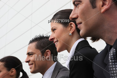 Line Of Smiling Executives Stock Photo
