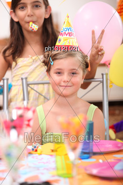Little Blonde Girl And Her Friend Doing The V Sign Posing For Her Birthday Stock Photo