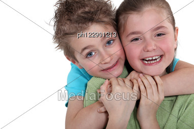 Little Boy And Little Girl Hugging Stock Photo