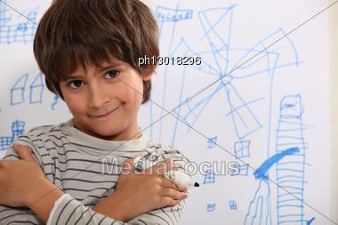 Little Boy Drawing Stock Photo