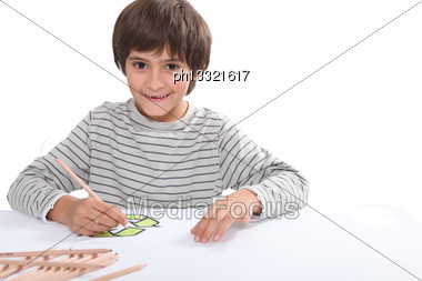 Little Boy Drawing Recycle Logo Stock Photo