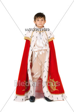 Little Boy Dressed In A Robe Of King Stock Photo