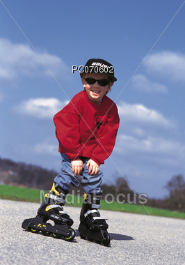 Little Boy on Rollerblades Stock Photo