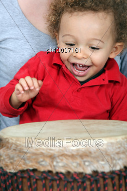 Little Boy Playing With Djembe Stock Photo