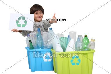 Little Boy Recycling Stock Photo