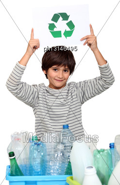 Little Boy Recycling Plastic Bottles Stock Photo