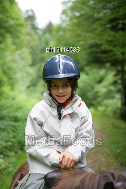 Little Boy Riding Horse For The First Time Stock Photo