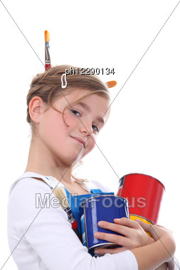 Little Carrying Paint Pots And Brushes Stock Photo