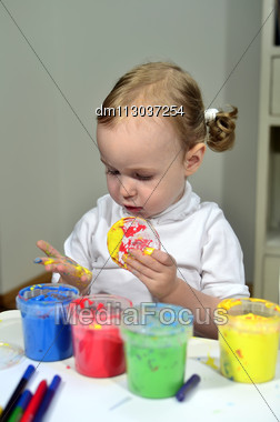 Little Girl Draws With Colored Inks Stock Photo