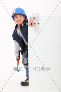 Little Girl Dressed As Builder Stood With Poster Stock Photo
