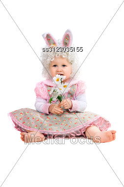 Little Girl With Flowers In Hand Wearing A Dress. Stock Photo
