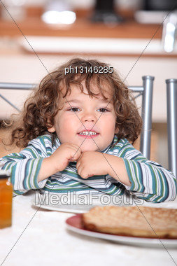 Little Girl Having Crepes For Dinner Stock Photo