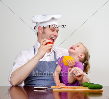 Little Girl And Her Father Having Fun In The Kitchen Stock Photo