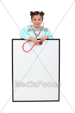 Little Girl Playing At Being A Doctor. Stock Photo
