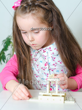 Little Girl Playing Domino On The Table Stock Photo