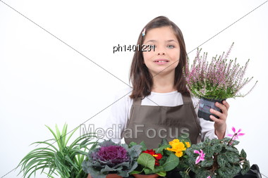 Little Girl Posing With Her Plants Stock Photo