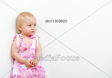 Little Girl Punished And Standing In The Corner Stock Photo