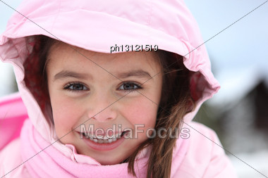 Little Girl Wearing Winter Clothes Stock Photo