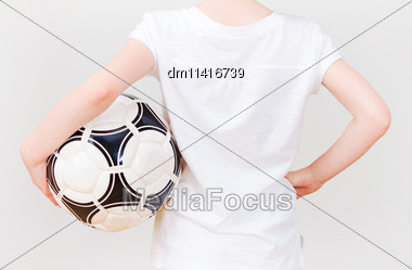 Little Girl In White T-shirt With Ball. Back View Stock Photo