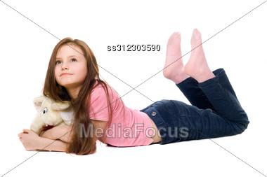 Little Girl With A Teddy Elephant. Stock Photo