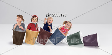 Little Girls In Plastic Cups Stock Photo