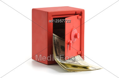 Little Red Safe With The Door Open And A Stack Of Dollar Bills Stock Photo