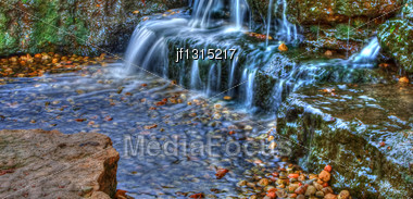 Long Exposure Of A Beautiful Cascading Waterfall In The Spring Time In High Dynamic Range Stock Photo