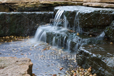 Long Exposure Of A Eautiful Cascading Waterfall In The Spring Time Stock Photo