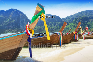 Long Tail Boats At The Beach, Thailand Stock Photo
