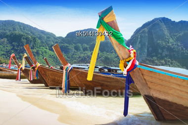 Long Tail Boats At The Beach, Thailand Stock Photo