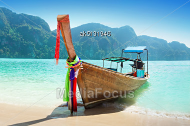 Longtale Boat At The Beach Stock Photo