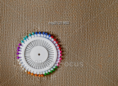 Lot Of Colorful Pins On A Sacking Background Stock Photo