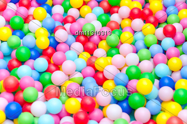 Lot Of Coloured Plastic Balls In Playroom Stock Photo