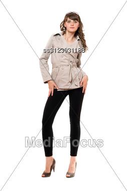 Lovely Girl Wearing A Coat And Black Leggings. Stock Photo