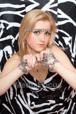 Lovely Young Blonde Stretches Out Her Hands In Chains Stock Photo