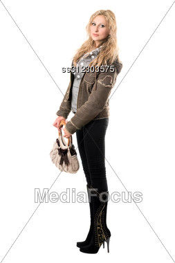 Lovely Young Blonde With A Handbag. Stock Photo