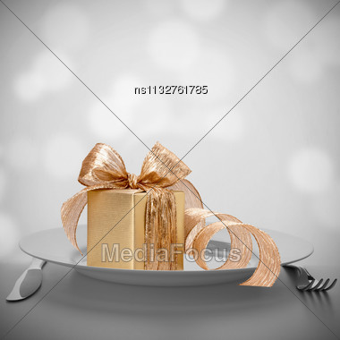Luxurious Gift On Plate. Feast Concept Stock Photo