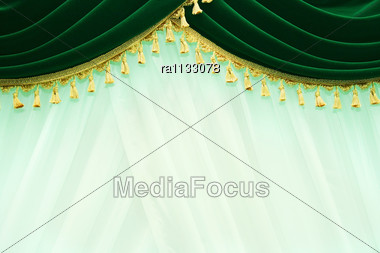 Luxurious Green Curtains. Stock Photo
