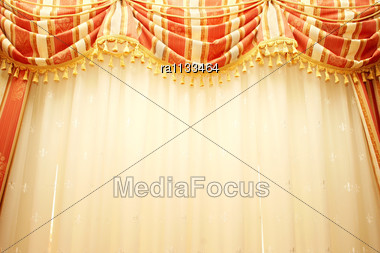 Luxurious Red And Yellow Curtains As A Background. Stock Photo
