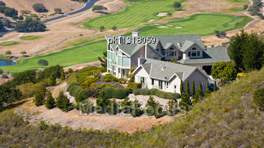Luxury Hillside Home Overlooking A Golf Course Stock Photo