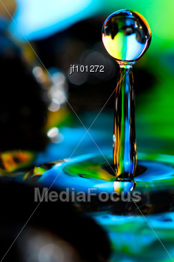 Macro Of Colorful Abstract Water Drop Stock Photo