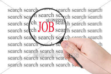 Magnifying Glass In Hand And Word Job - Business Concept Stock Photo