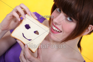 Making Face Slice Of Bread Stock Photo