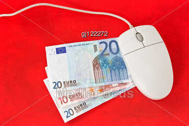 Making Money Online Concept. Computer Mouse And Money On Red Background. Stock Photo