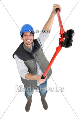 Male Construction Worker With Pliers. Stock Photo