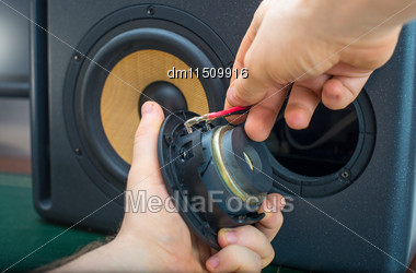 Male Hand Connecting Professional Studio Monitor Speaker Stock Photo