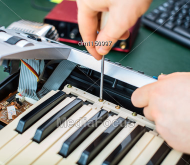 Male Hand Fixing Midi Keyboard Controller Stock Photo