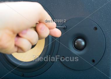 Male Hand Fixing Professional Studio Monitor Stock Photo