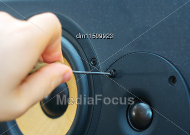 Male Hand Fixing Professional Studio Monitor Stock Photo