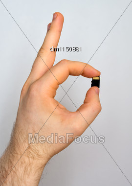 Male Hand Holding Micro SD Card Stock Photo
